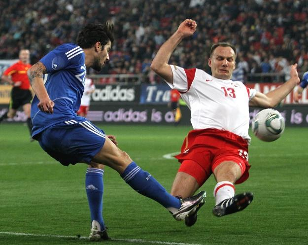 Panagiotis Kone jest atakowany przez Arkadiusza Głowackiego /PAP/EPA
