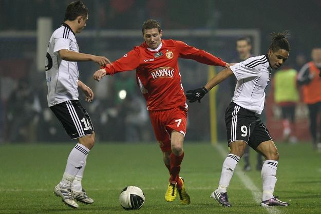Paul Grischok (w środku) zdobył dla Widzewa dwa gole w meczu z Olimpią. Fot. Mateusz Trzuskowski /AFP