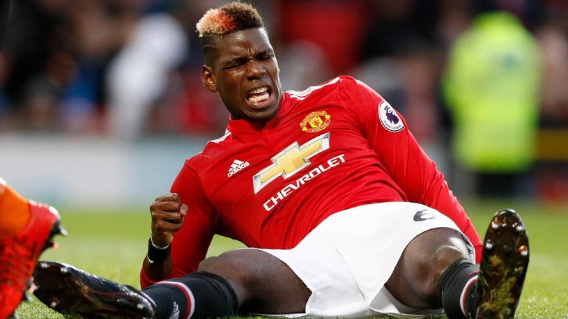 Paul Pogba reacts to an injury against Brighton earlier this season /PA Sport