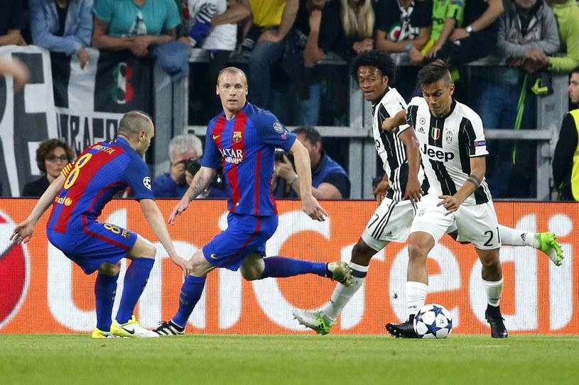 Paulo Dybala (przy piłce) strzela pierwszego gola dla Juventusu /AFP