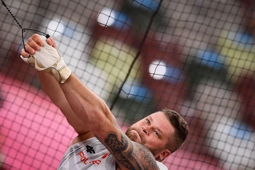Paweł Fajdek zdobył w Tokio brązowy medal igrzysk olimpijskich w rzucie młotem /BEN STANSALL /AFP
