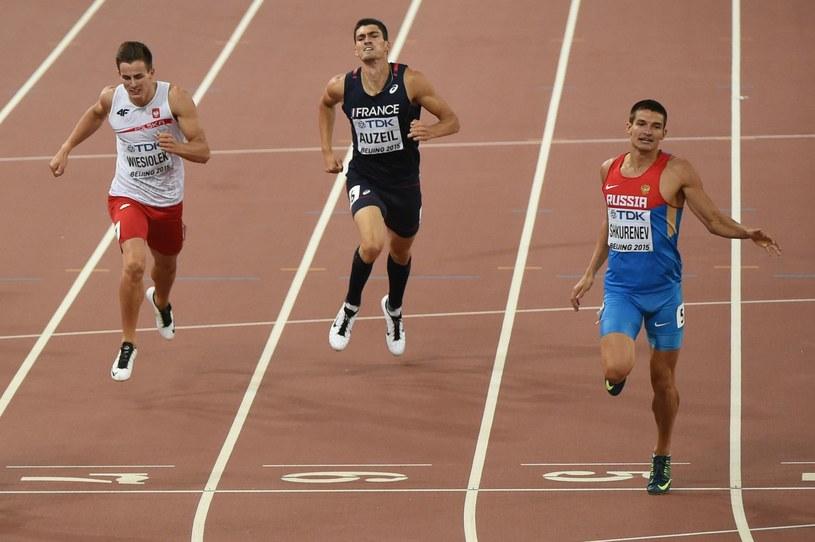 Paweł Wiesiołek (pierwszy z lewej) podczas mistrzostw w Pekinie /AFP