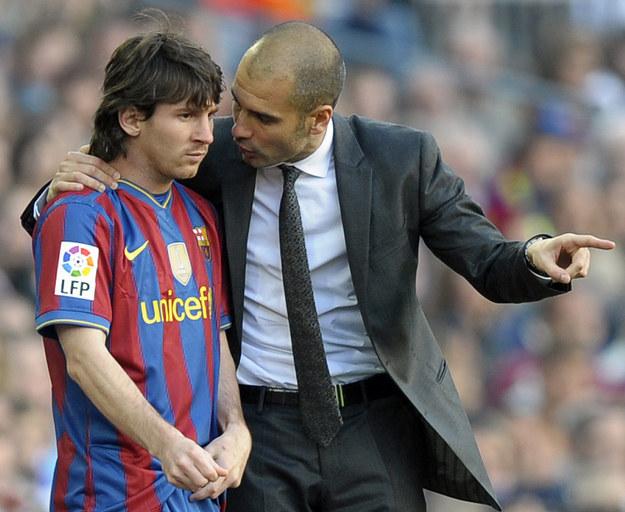 Pep Guardiola i Leo Messi. /AFP