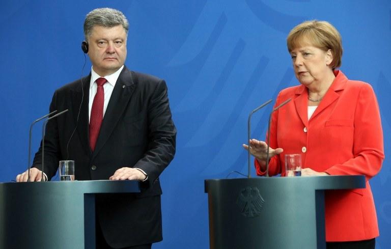 Petro Poroszenko i Angela Merkel /AFP