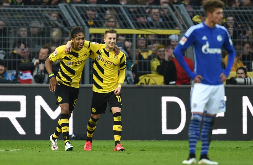 Pierre-Emerick Aubameyang i Marco Reus rozmontowali Schalke. /AFP