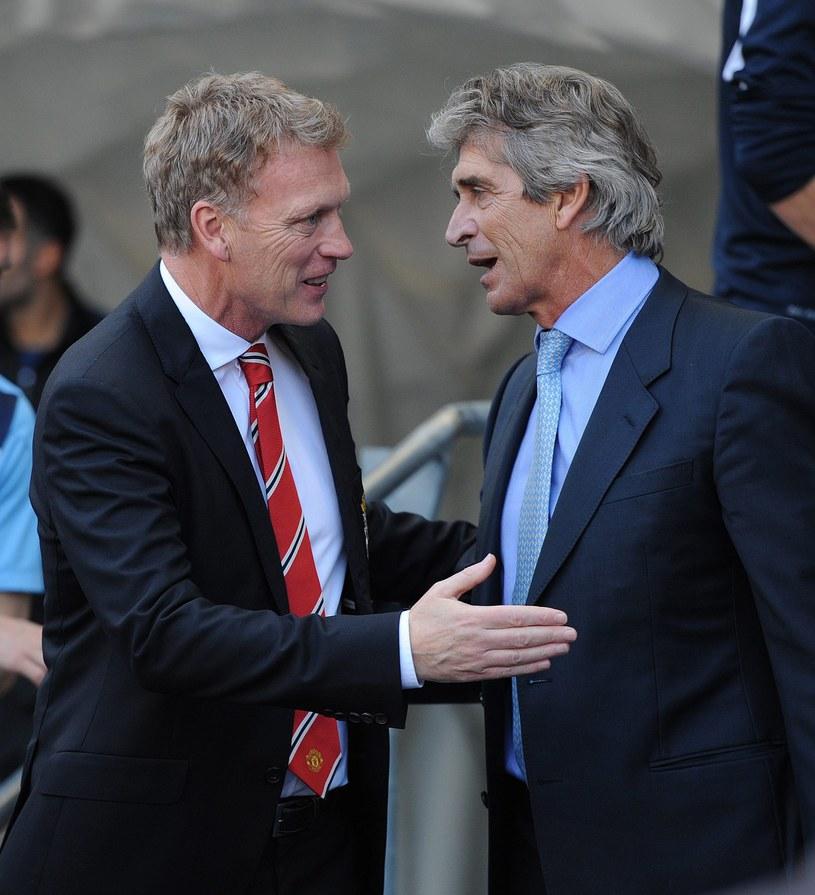 Pierwsze bezpośrednie stracie w derbach Manchesteru zdecydowanie dla Manuela Pellegriniego (z prawej). Obok David Moyes /AFP
