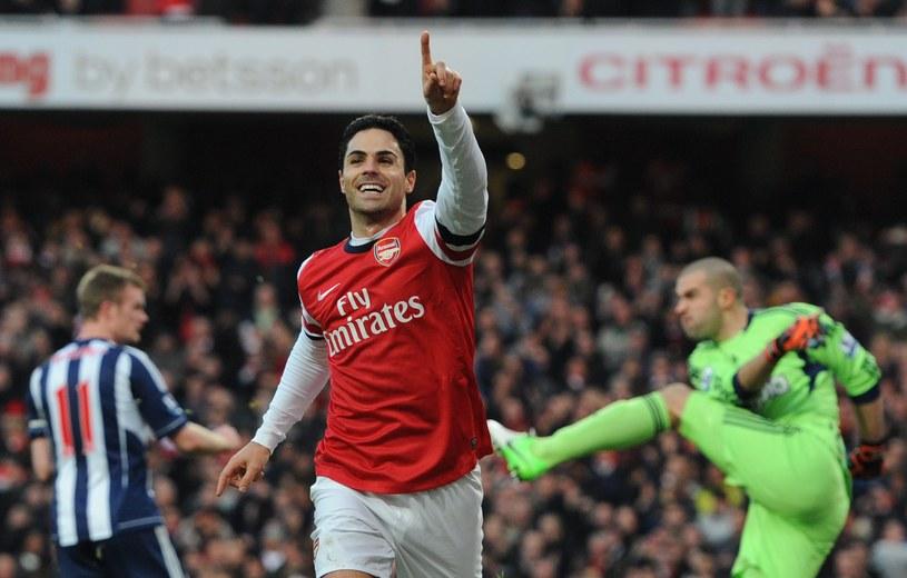 Piłkarz Arsenalu Mikel Arteta cieszy po zdobyciu gola w meczu z West Bromwich Albion /AFP