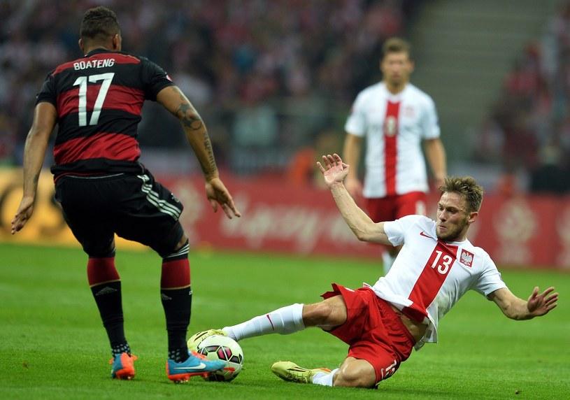 Piłkarz reprezentacji Polski Maciej Rybus (z prawej) /AFP