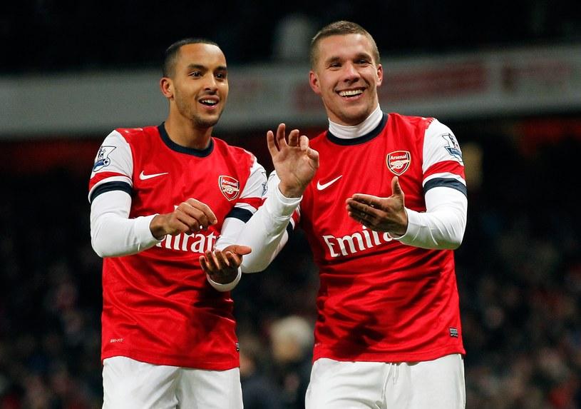 Piłkarze Arsenalu - Theo Walcott i Lukas Podolski (z prawej) /AFP