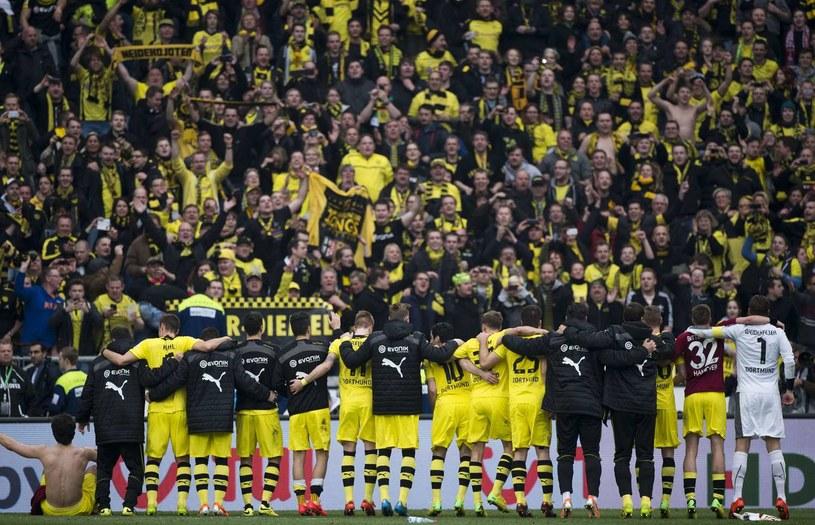 Piłkarze Borussii Dortmund mogą liczyć na swoich kibiców /AFP