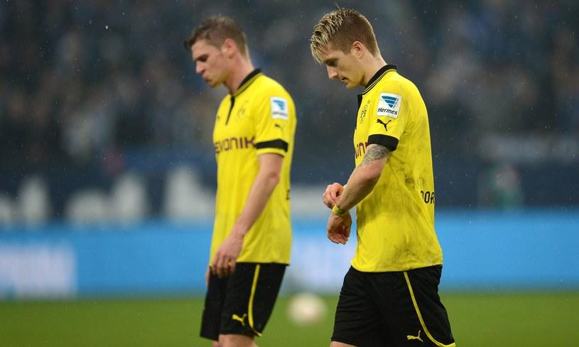 Piłkarze Borussii - Łukasz Piszczek i Marco Reus przeżywają porażkę z Schalke /AFP