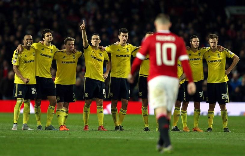 Piłkarze Middlesbrough cieszą się po zmarnowanym karnym Wayne'a Rooneya /AFP