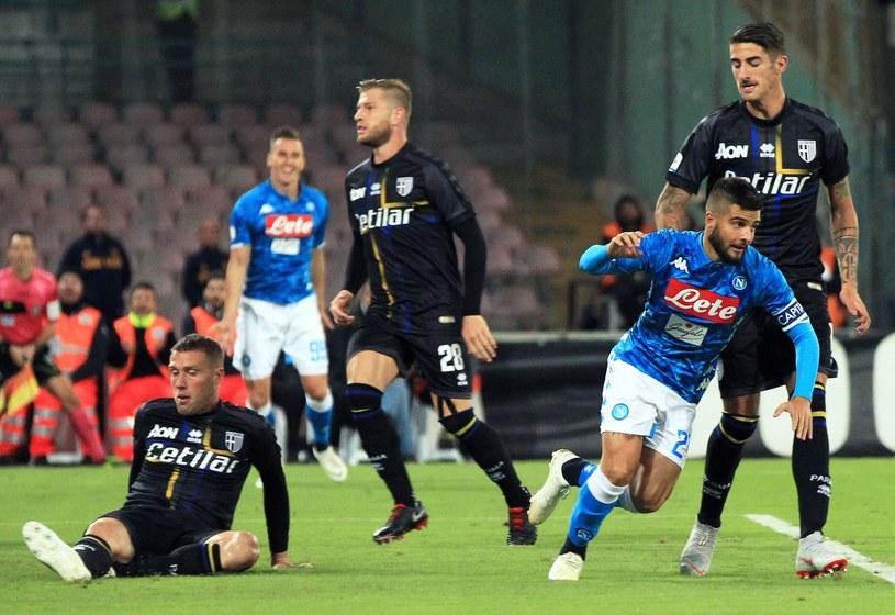 Piłkarze Parmy (na czarno) w meczu z Napoli /AFP