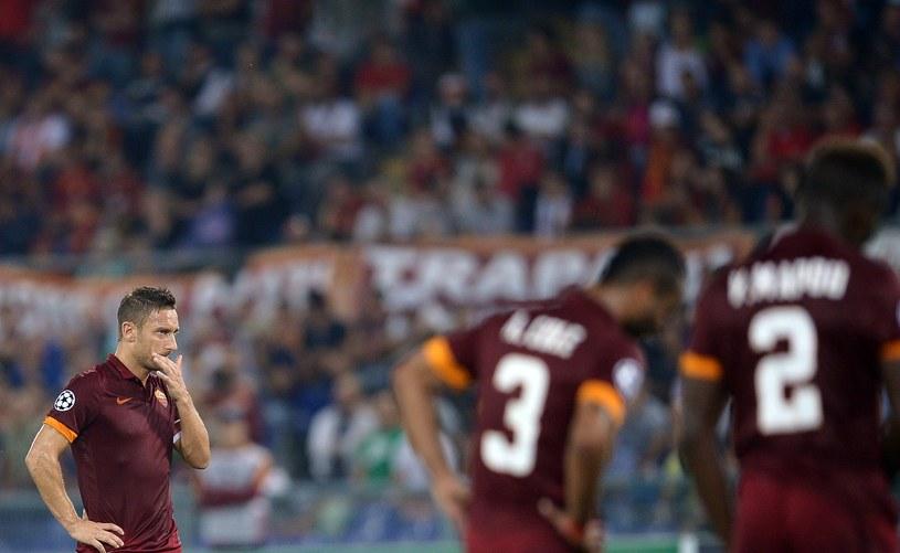Piłkarze Romy załamani podczas meczu z Bayernem /AFP