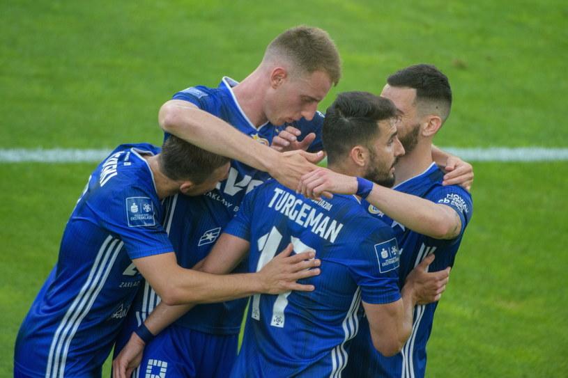 Piłkarze Wisły Kraków cieszą się z gola podczas meczu grupy spadkowej Ekstraklasy z ŁKS Łódź /Grzegorz Michałowski /PAP