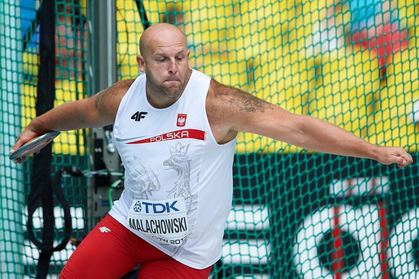 Piotr Małachowski już w pierwszej próbie uzyskał wynik lepszy od minimum kwalifikacyjnego /Fot. Adam Warżawa /PAP