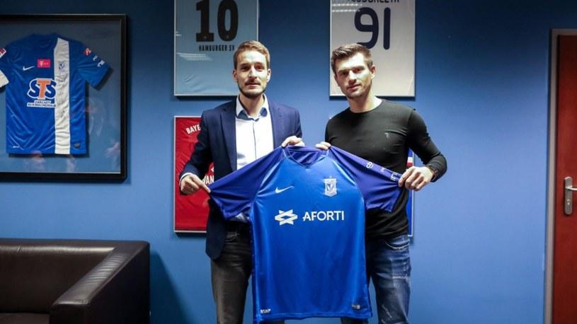 Piotr Tomasik (z prawej) /From Official Website