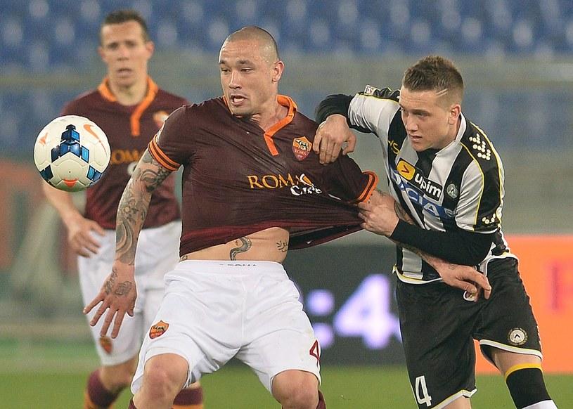 Piotr Zieliński (z prawej) w meczu z Romą /AFP