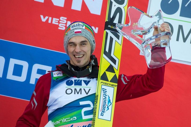 Piotr Żyła na podium zawodów Pucharu Świata w Planicy /AFP