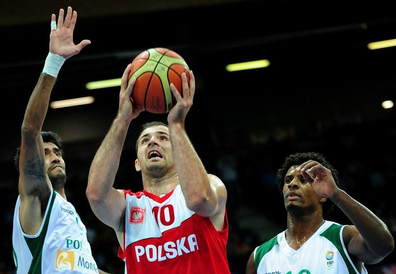 Polski koszykarz Szymon Szewczyk /AFP