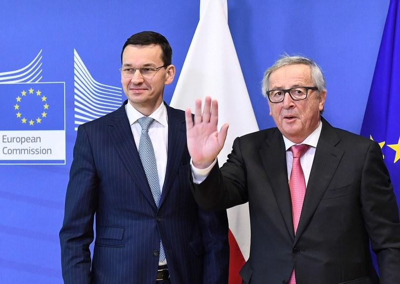 Premier Mateusz Morawiecki z szefem Komisji Europejskiej Jean-Claude'em Junckerem /EMMANUEL DUNAND /East News