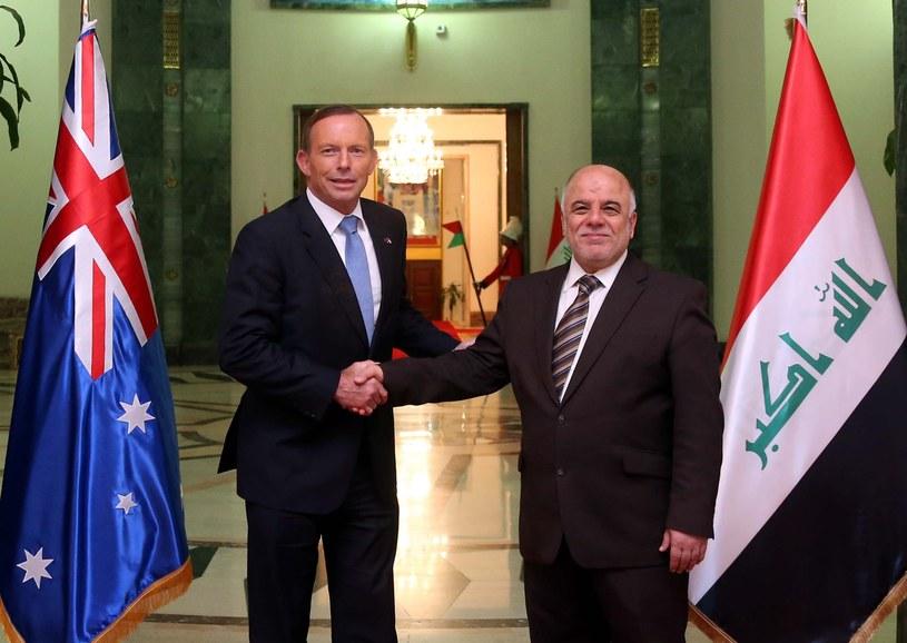 Premierzy Tony Abbott (Australia) i Haider al-Abadi (Irak) /AFP