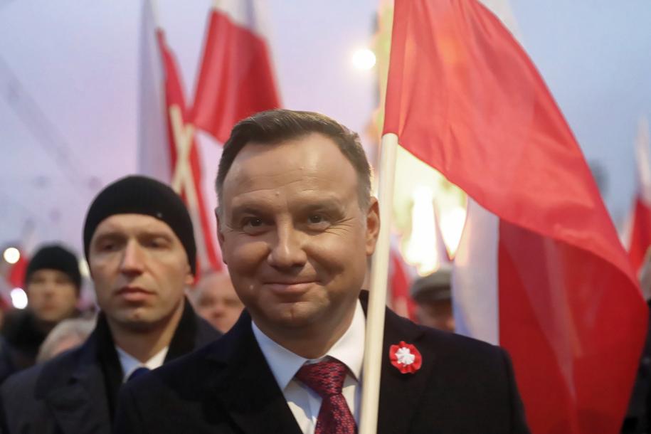 """Prezydent Andrzej Duda podczas Biało-Czerwonego Marszu """"Dla Ciebie Polsko"""" / Tomasz Gzell    /PAP"""