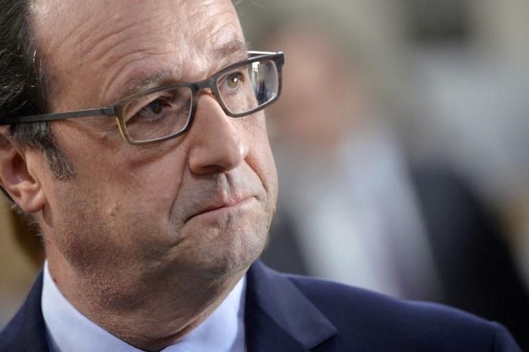 """Prezydent Francji Francois Hollande: """"Nic nie jest jeszcze zrobione, ale wszystko musi być zrobione"""" /AFP"""