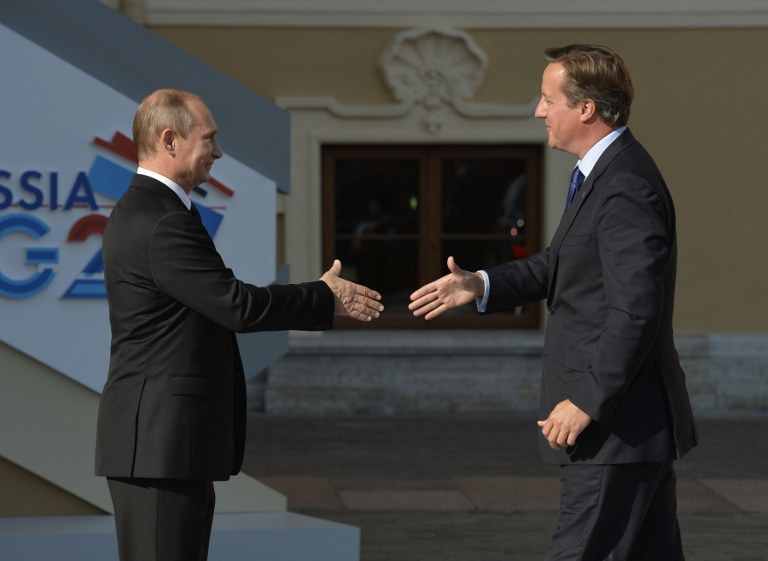 Prezydent Rosji, Władimir Putin i brytyjski premier David Cameron /ERIC FEFERBERG / AFP /AFP