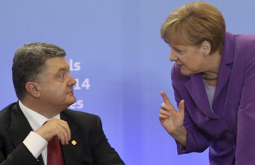 Prezydent Ukrainy Petro Poroszenko i kanclerz Niemiec Angela Merkel /AFP