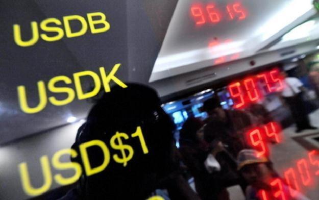 Prognozy Saxo Banku dla głównych walut G10 /AFP