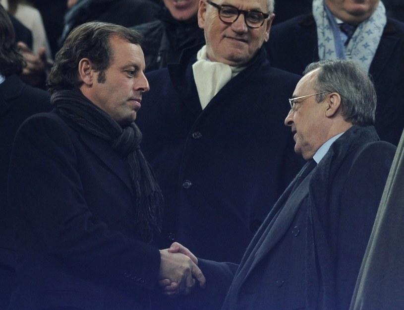 Przed rewanżem w Pucharze Króla Sandro Rosell (z lewej) nie przeczuwał katastrowy, gdy witał prezydenta Realu - Floretina Pereza (z prawej). /AFP