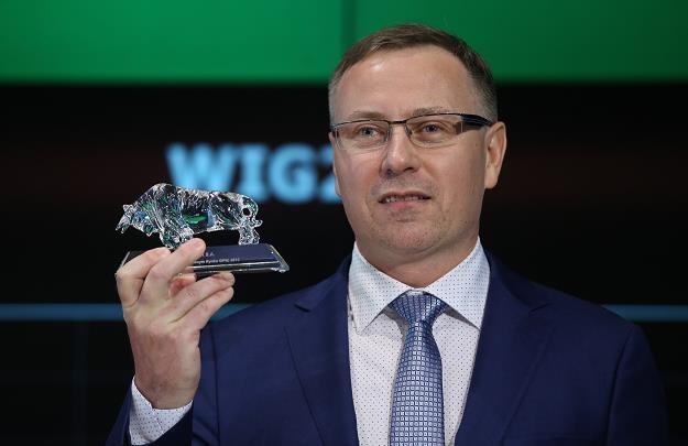 Przemysław Skrzydlak, prezes Izo-Blok, w czasie debiutu na rynku gółownym GPW /PAP