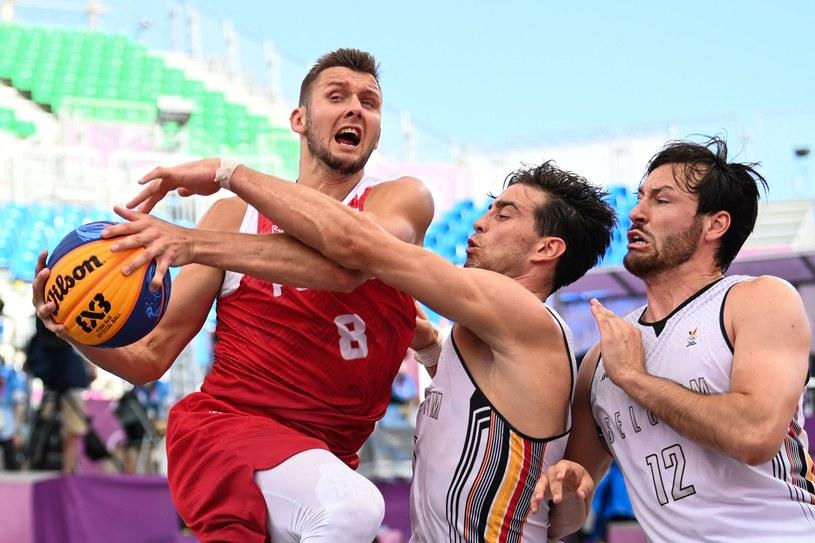 Przemysław Zamojski w meczu z Belgami /AFP