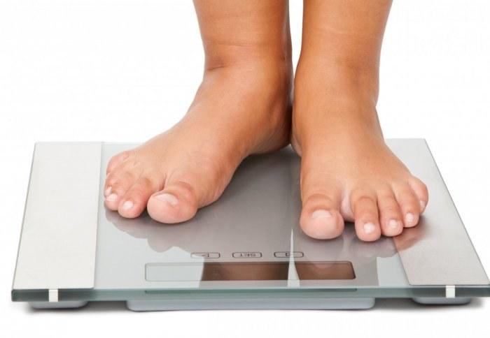 Przybieranie na wadze objaw choroby /© Photogenica