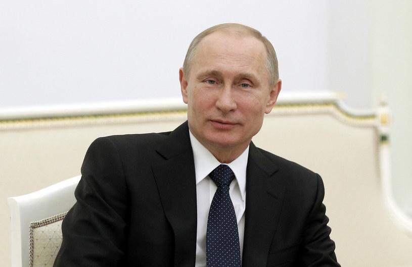 Putin na naradzie: sankcje z powodu Krymu nie są fatalne /AFP