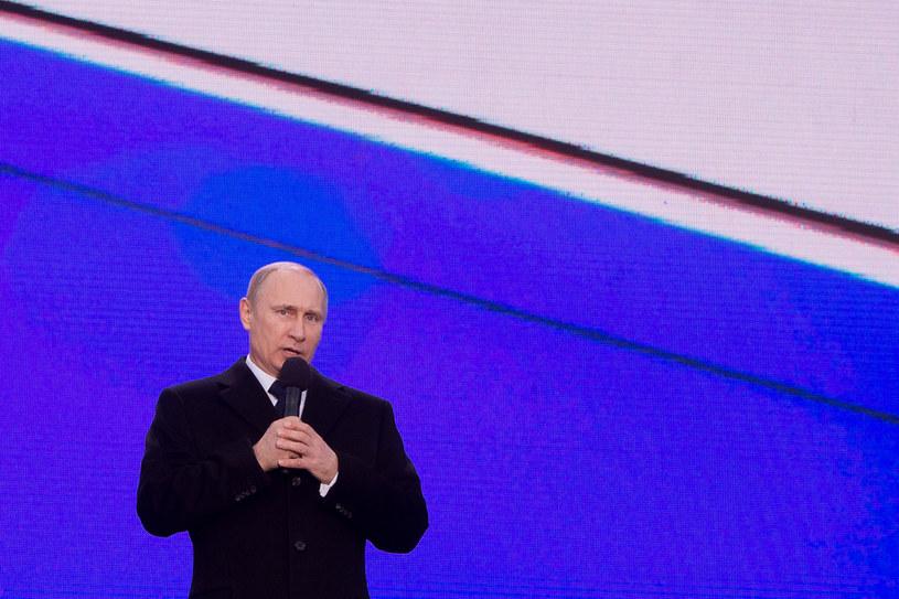 Putin podczas wiecu-koncertu poświęconego pierwszej rocznicy przyłączenia Krymu do Rosji /AFP