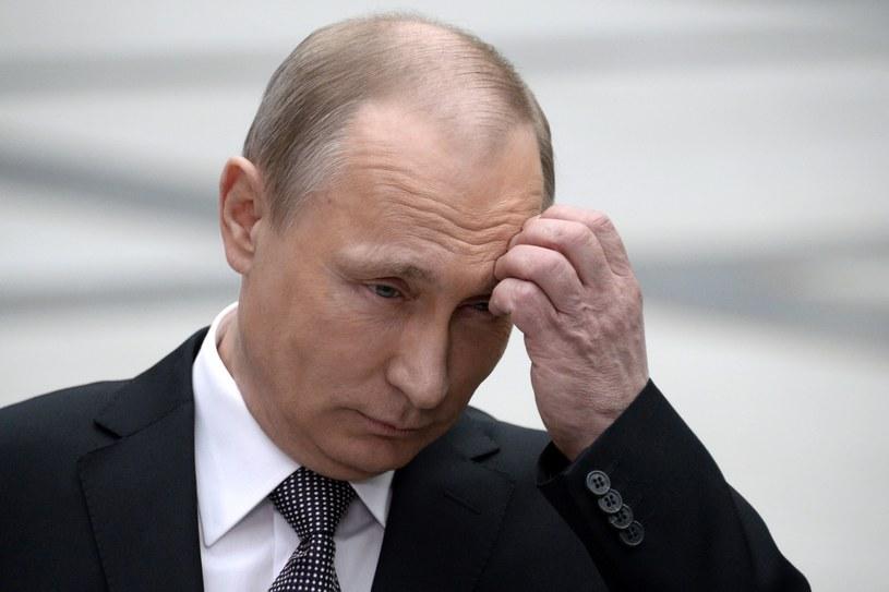 Pytanie o morderstwo Ołesia Buzyny nie zaskoczyło Władimira Putina w czasie konferencji /AFP
