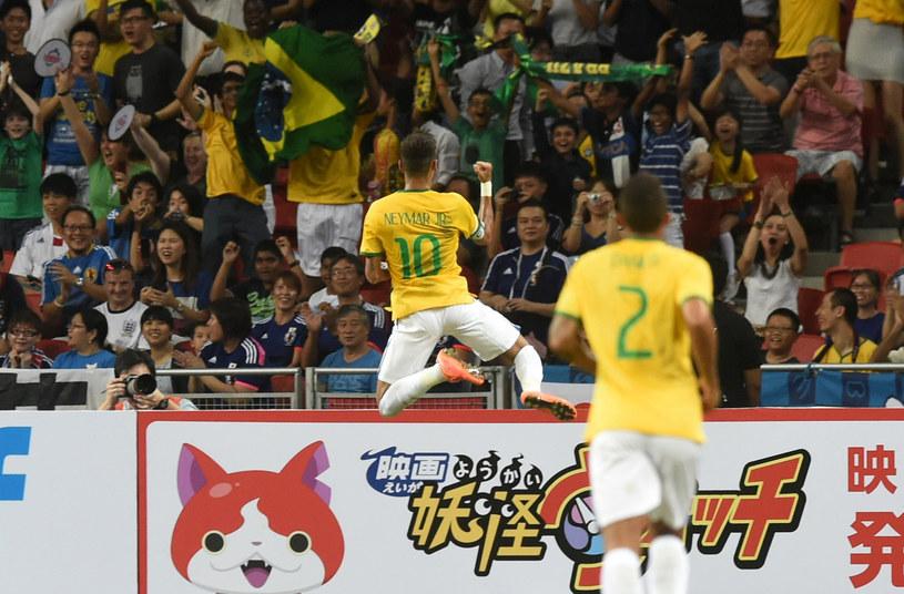 Radość Neymara po pierwszej bramce w meczu z Japonią /ROSLAN RAHMAN /AFP