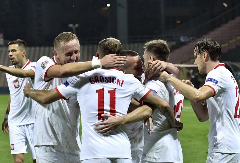 Radość piłkarzy reprezentacji Polski po uzyskaniu negatywnych wyników testów na koronawirusa, koloryzowane /AP /East News