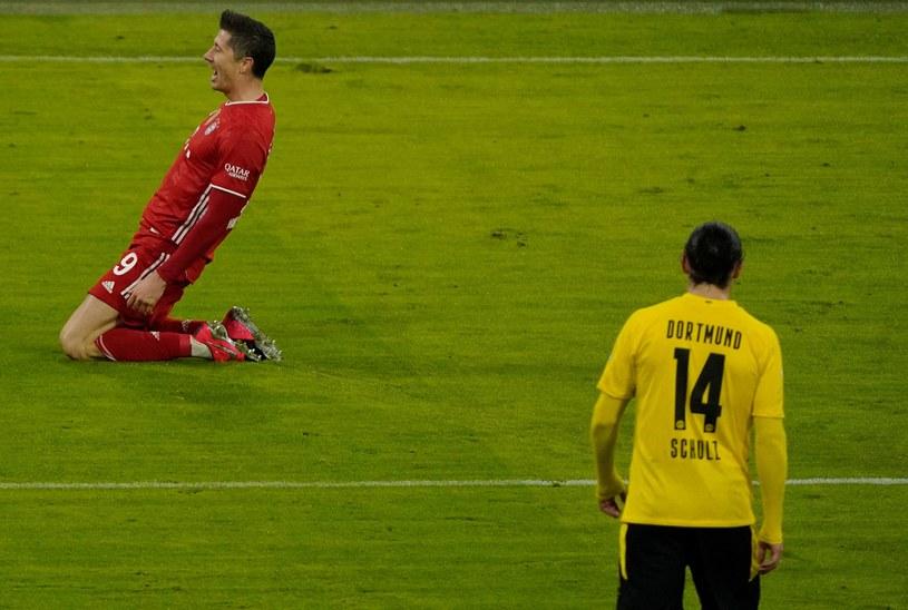Radość Roberta Lewandowskiego w starciu z Borussią Dortmund /GUENTER SCHIFFMANN /AFP