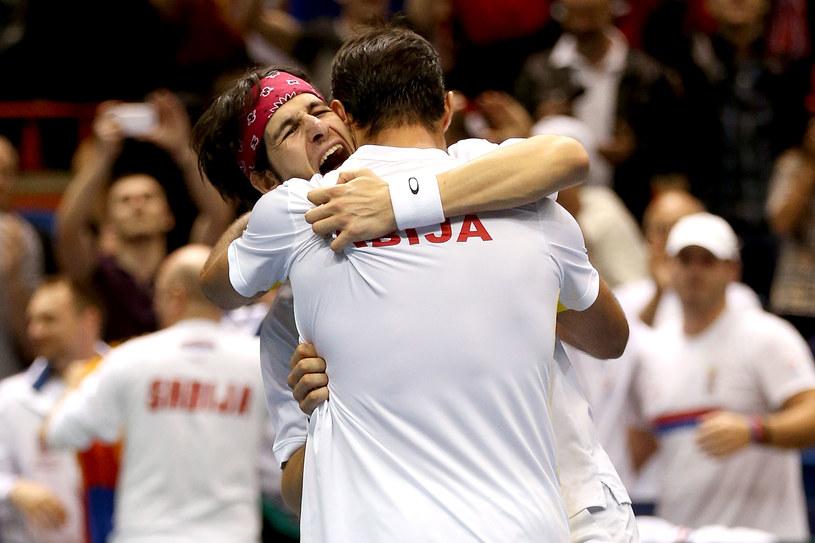 Radość serbskich tenisistów po pokonaniu braci Bryanów /AFP
