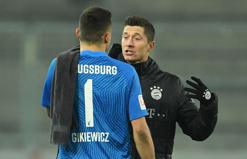 Rafał Gikiewicz i Robert Lewandowski /AFP
