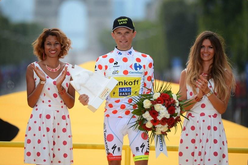 Rafał Majka w otoczeniu pięknych pań. Polak wygrał klasyfikację górską Tour de France 2014 /AFP