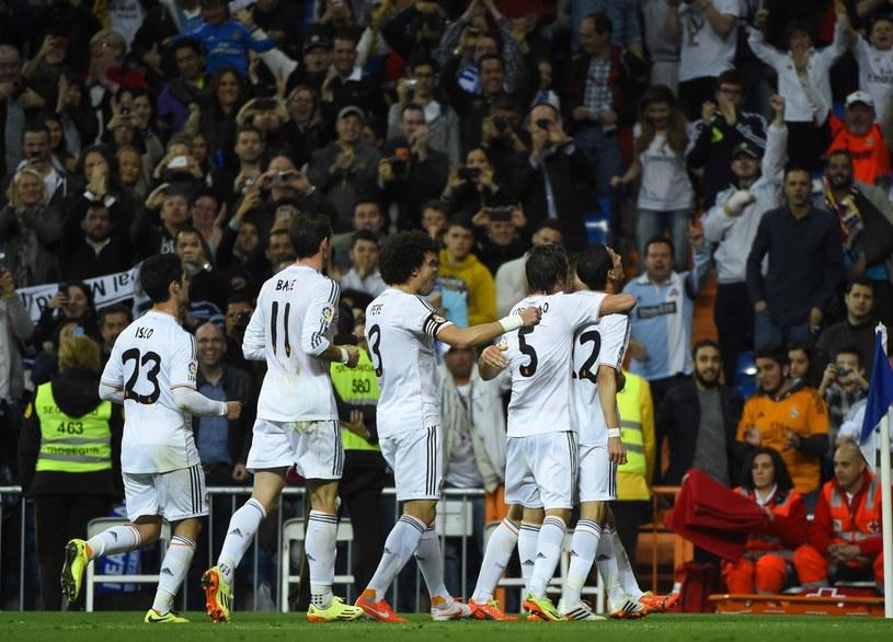 Real dogonił w tabeli prowadzące Atletico /AFP