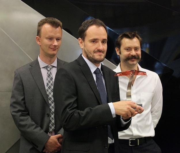 Remigiusz Kościelny, Jarosław Wojczakowski, Paul Bragiel z Vivid Games w czasie debiutu w ASO /PAP