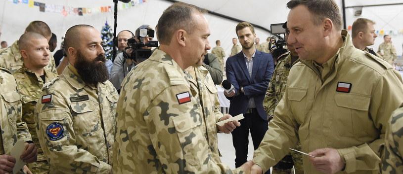 rezydent RP Andrzej Duda  podczas spotkania wigilijnego, w ramach wizyty w bazie Al Dżabir w Kuwejcie /Radek Pietruszka /PAP