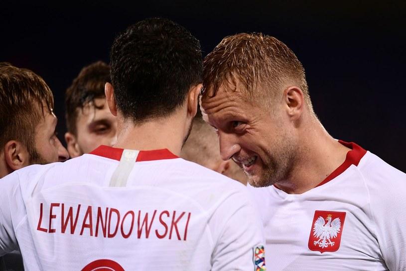 Robert Lewandowski i Kamil Glik /AFP