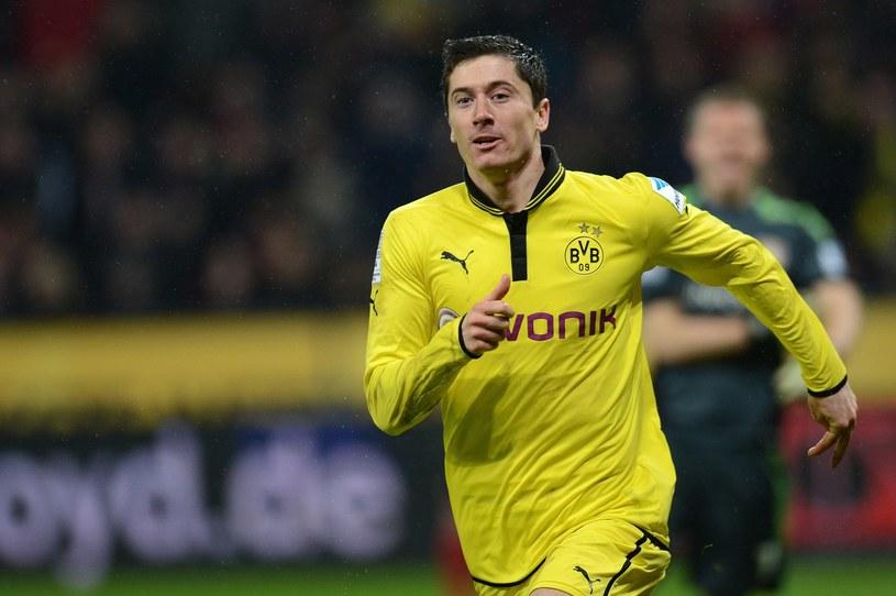 Robert Lewandowski jeszcze do końca sezonu będzie piłkarzem Borussii Dortmund /AFP
