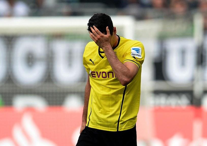 Robert Lewandowski jeszcze przez pół roku będzie grał w Borussii Dortmund /AFP